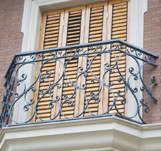Decorative wrought iron balconies in