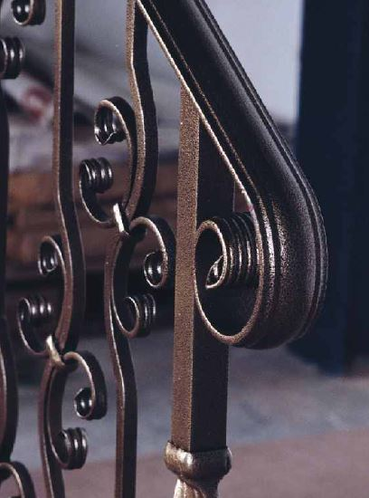 Railings and finials in wrought iron stair